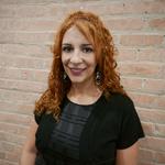 Melva Flores sirve como lider del Ministerio de Traduccion en la Iglesia Rebano